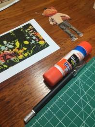 Glue stick, cutting mat, X-acto knife: collage supplies