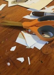 Scissors, sharpie, and cut paper