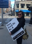 carrying a sign in town